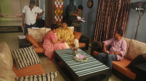 Director Kapilas Bhuyan looks on while Sabita Dash & Dr. Chitta Mishra enact an intimate moment as the parents of the female lead